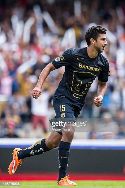 Eduardo Herrera of Pumas celebrates after scoring the second goal for his team during a match between Pumas UNAM and Chiapas as part of 10th round...