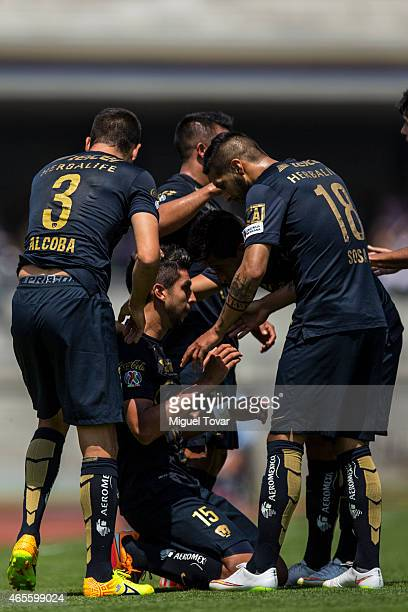 Eduardo Herrera of Pumas celebrates with his teammates after scoring the first goal of his team during a match between Pumas UNAM and Morelia as part...