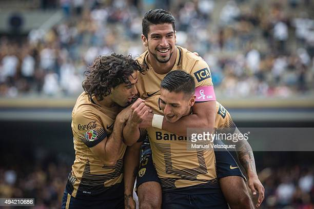 Eduardo Herrera of Pumas celebrates with Ismael Sosa and Matias Britos after socirng the first goal of his team during the 14th round match between...