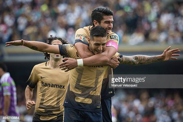 Eduardo Herrera of Pumas celebrates with teammate Ismael Sosa after scoring the first goal of his team during the 14th round match between Pumas UNAM...