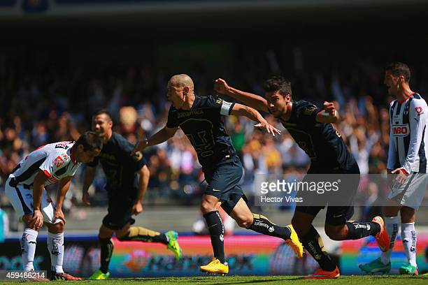 Eduardo Herrera of Pumas UNAM celebrateS with his teammates after scoring the third goal of his team during a match between Pumas UNAM and Monterrey...