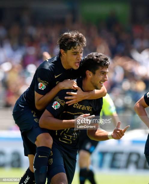 Eduardo Herrera of Pumas UNAM celebrates with Jose Carlos Van Rankin after scoring during a match between Pumas UNAM and Xolos Tijuana as a part of...