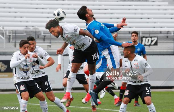 Eduardo Herrera of Scottish club Rangers FC tries to head the ball past Kazim of Brazilian club Corinthians during their Florida Cup soccer game at...