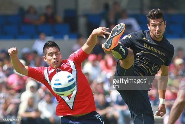 Eduardo Herrera of Veracruz vies for the ball with Adrian Cortes of Pumas during their Mexican Apetura tournament football match on November 2 2014...