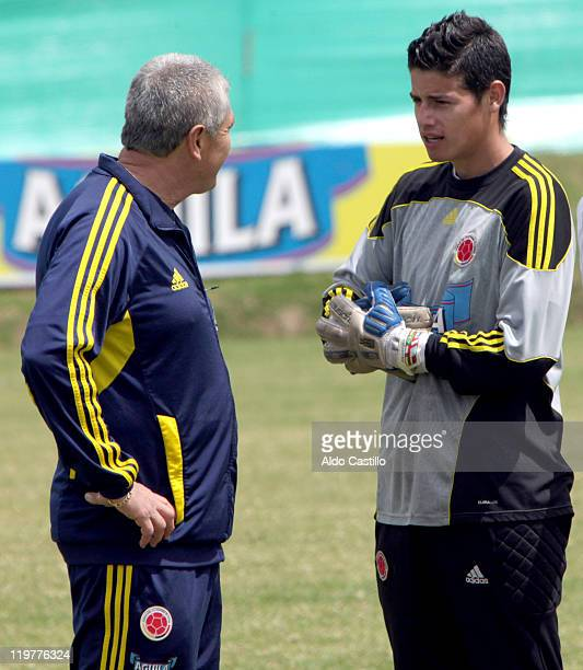 Eduardo Lara colombia`s coach and James Rodriguez talk during a training session prior to the match between Colombia and Francia for the Group A of...