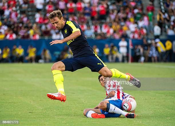 Eduardo Lopez of Guadalajara steals the ball from Nacho Monreal of Arsenal during the friendly match between Arsenal and CD Guadalajara at StubHub...