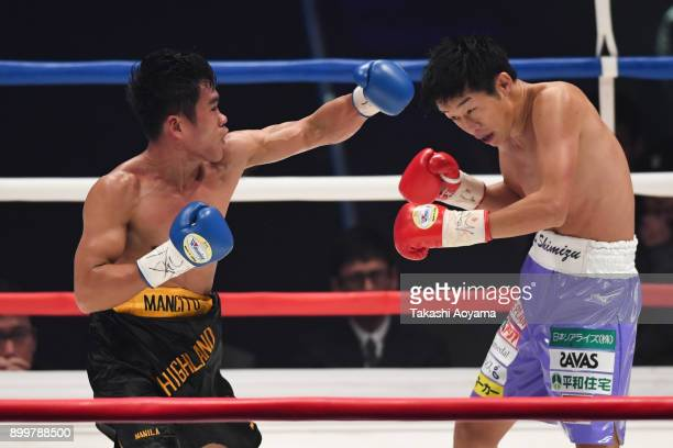 Eduardo Mancito of Philippines punches Satoshi Shimizu of Japan during their OPBF Featherweight Title Bout at the Yokohama Cultural Gymnasium on...