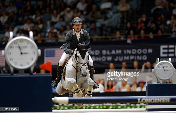 Eduardo Menezes of Brazil competes during the Longines Grand Prix event at the Longines Masters of Los Angeles 2016 at the Long Beach Convention...