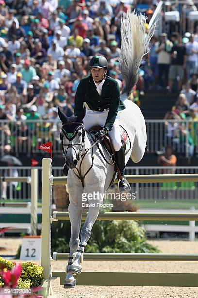 Eduardo Menezes of Brazil rides Quintol during the Jumping Team Round 2 on Day 12 of the Rio 2016 Olympic Games at the Olympic Equestrian Centre on...