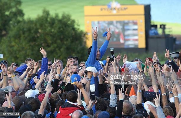 Eduardo Molinari and spectators celebrate after Europe win the 38th Ryder Cup at the Twenty Ten Course at Celtic Manor in Newport Wales on Monday...