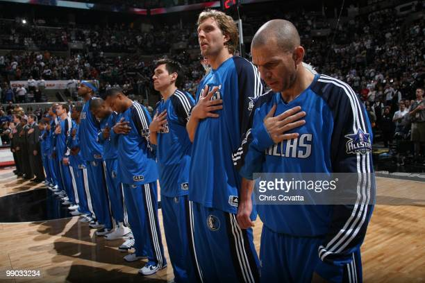 Eduardo Najera Dirk Nowitzki and Jason Kidd of the Dallas Mavericks line up with their teammates for the singing of the national anthem at the start...