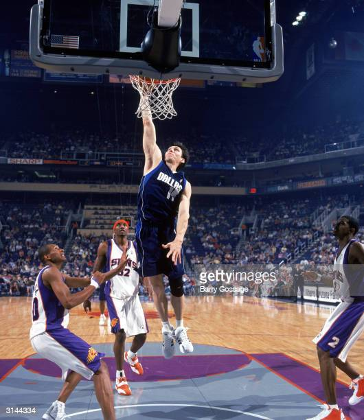 Eduardo Najera of the Dallas Mavericks goes in for a layup during the game against the Phoenix Suns at America West Arena on March 13 2004 in Phoenix...