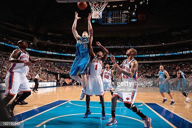 Eduardo Najera of the Dallas Mavericks rebounds against Chris Duhon and Wilson Chandler of the New York Knicks during the game on March 13 2010 at...