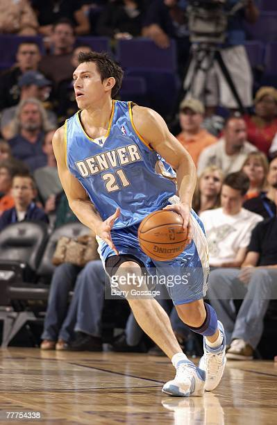 Eduardo Najera of the Denver Nuggets moves the ball during a preseason game against the Phoenix Suns at US Airways Center on October 25 2007 in...