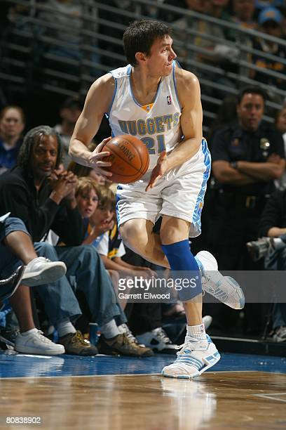 Eduardo Najera of the Denver Nuggets moves the ball during the NBA game against the Sacramento Kings on April 5 2008 at the Pepsi Center in Denver...