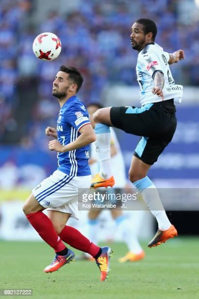 Eduardo Neto of Kawasaki Frontale and Hugo Vieira of Yokohama F.Marinos compete for the ball during the J.League J1 match between Yokohama F.Marinos...