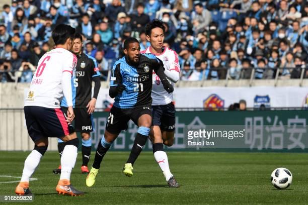 Eduardo Neto of Kawasaki Frontale and Kenyu Sugimoto of Cerezo Osaka compete for the ball during the Xerox Super Cup match between Kawasaki Frontale...