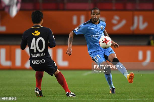 Eduardo Neto of Kawasaki Frontale and Mitsuo Ogasawara of Kashima Antlers compete for the ball during the JLeague J1 match between Kashima Antlers...