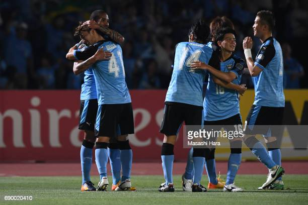 Eduardo Neto of Kawasaki Frontale celebrates the third goal with Akihiro Ienaga during the AFC Champions League Round of 16 match between Kawasaki...