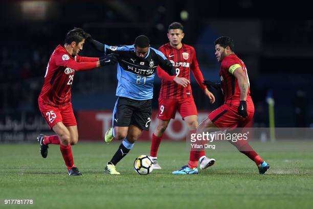 Eduardo Neto of Kawasaki Frontale dribbles against Odil Akhmedov and Hulk of Shanghai SIPG during the AFC Champions League Group F match between...