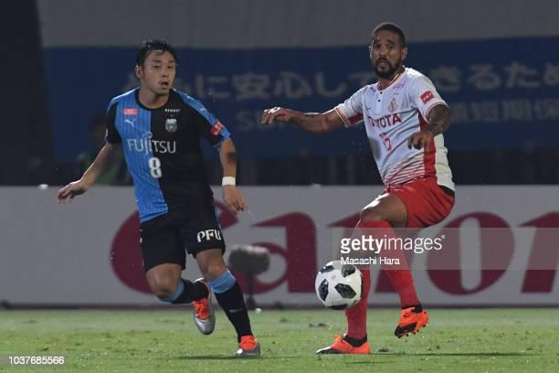 Eduardo Neto of Nagoya Grampus and Hiroyuki Abe of Kawasaki Frontale compete for the ball during the JLeague J1 match between Kawasaki Frontale and...
