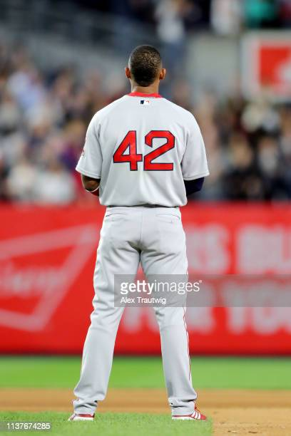 Eduardo Núñez stands on the field during the playing of God Bless America during the game between the Boston Red Sox and the New York Yankees at...