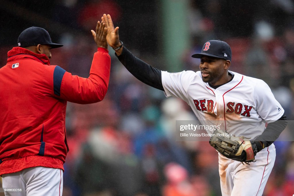 Eduardo Nunez #36 and Jackie Bradley Jr. #18 of the Boston Red Sox celebrate a victory against the Baltimore Orioles on April 15, 2018 at Fenway Park in Boston, Massachusetts.