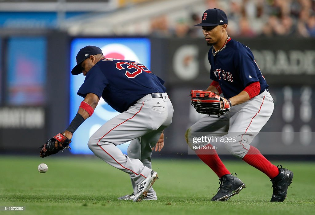 Eduardo Nunez #36 and Xander Bogaerts #2 of the Boston Red Sox can't catch a pop fly in shallow right field that drops in for an RBI single by Gary Sanchez #24 during the fifth inning of a game at Yankee Stadium on August 31, 2017 in the Bronx borough of New York City.
