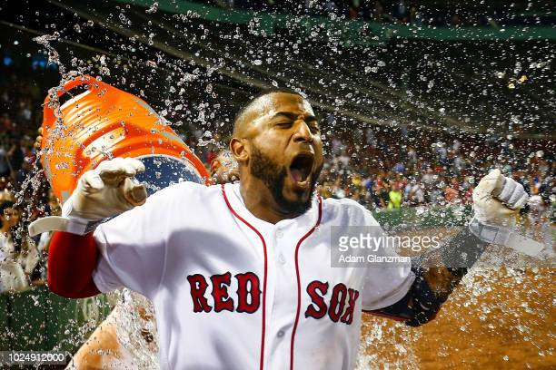 Eduardo Nunez is doused in gatorade by Xander Bogaerts of the Boston Red Sox following his gamewining RBI in the ninth inning of a game against the...