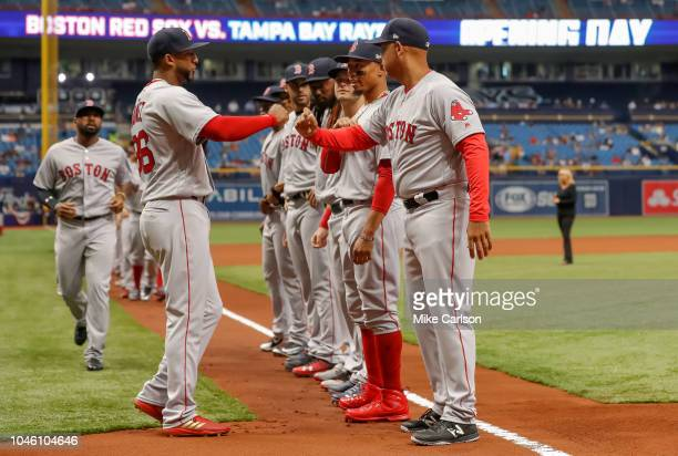 Eduardo Nunez left greets Alex Cora of the Boston Red Sox during introductions prior to the game between the Boston Red Sox and the Tampa Bay Rays at...
