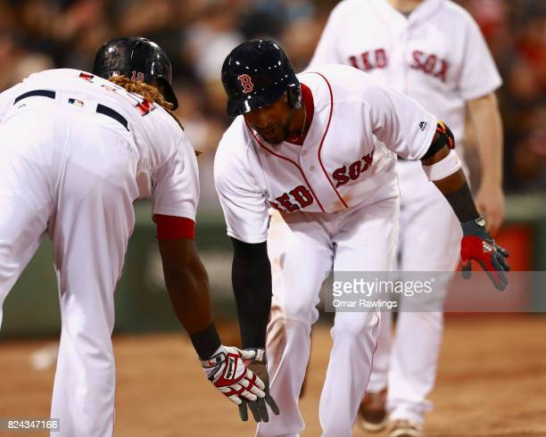 Eduardo Nunez lowfives Hanley Ramirez of the Boston Red Sox after hitting a home run in the bottom of the third inning during the game against the...