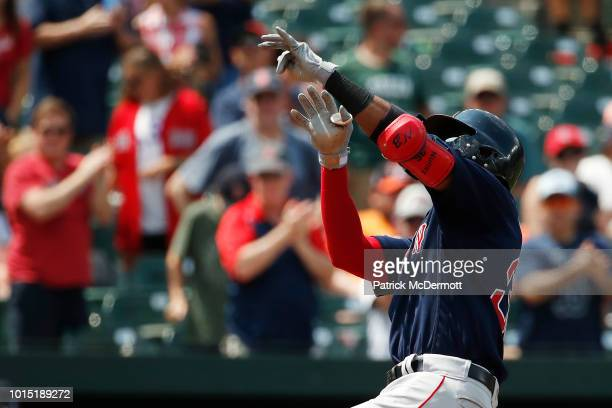 Eduardo Nunez of the Boston Red Sox celebrates after hitting a tworun home run in the fifth inning against the Baltimore Orioles during game one of a...