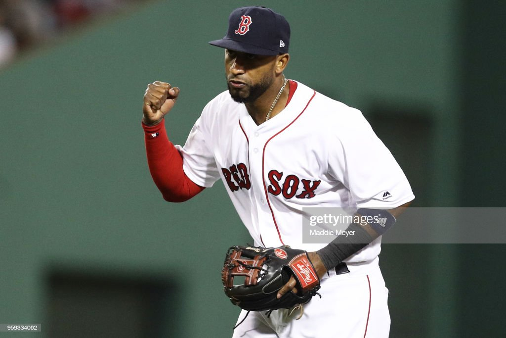 Eduardo Nunez #36 of the Boston Red Sox celebrates after turning a double play over Khris Davis #2 of the Oakland Athletics during the eighth inning at Fenway Park on May 16, 2018 in Boston, Massachusetts.