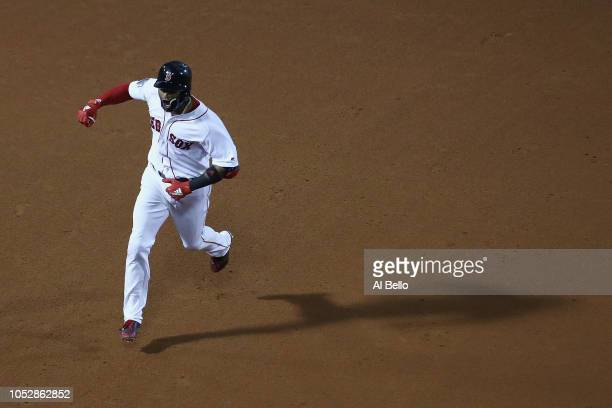 Eduardo Nunez of the Boston Red Sox celebrates his threerun home run during the seventh inning against the Los Angeles Dodgers in Game One of the...