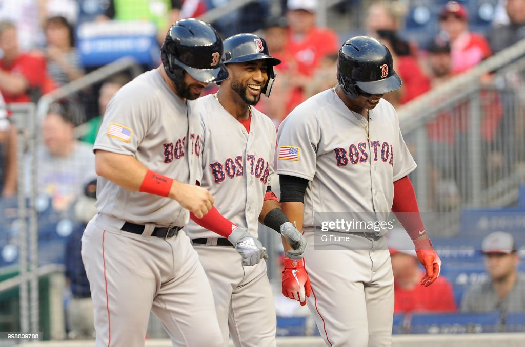 Eduardo Nunez #36 of the Boston Red Sox celebrates with Mitch Moreland #18 and Rafael Devers #11 after hitting a three-run home run in the second inning against the Washington Nationals at Nationals Park on July 3, 2018 in Washington, DC.