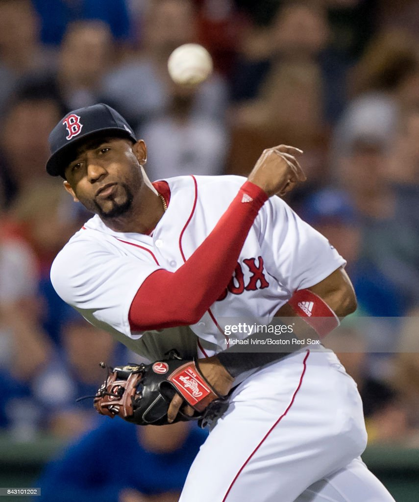 Eduardo Nunez #36 of the Boston Red Sox complete a put out against the Toronto Blue Jays in the eighth inning at Fenway Park on September 5, 2017 in Boston, Massachusetts.