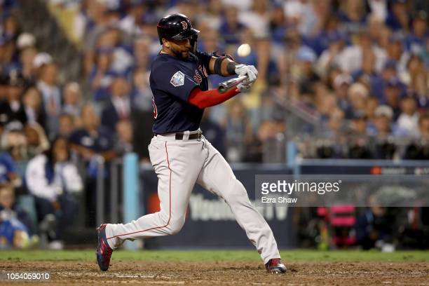 Eduardo Nunez of the Boston Red Sox flies into a double play during the tenth inning against the Los Angeles Dodgers in Game Three of the 2018 World...