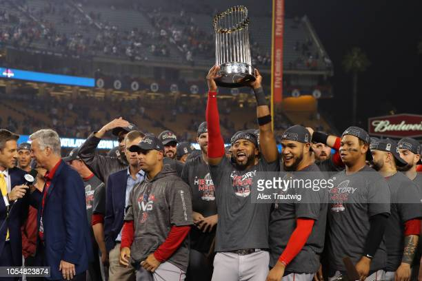 Eduardo Nunez of the Boston Red Sox holds up the World Series trophy as the Red Sox celebrate defeating the Los Angeles Dodgers in Game 5 of the 2018...