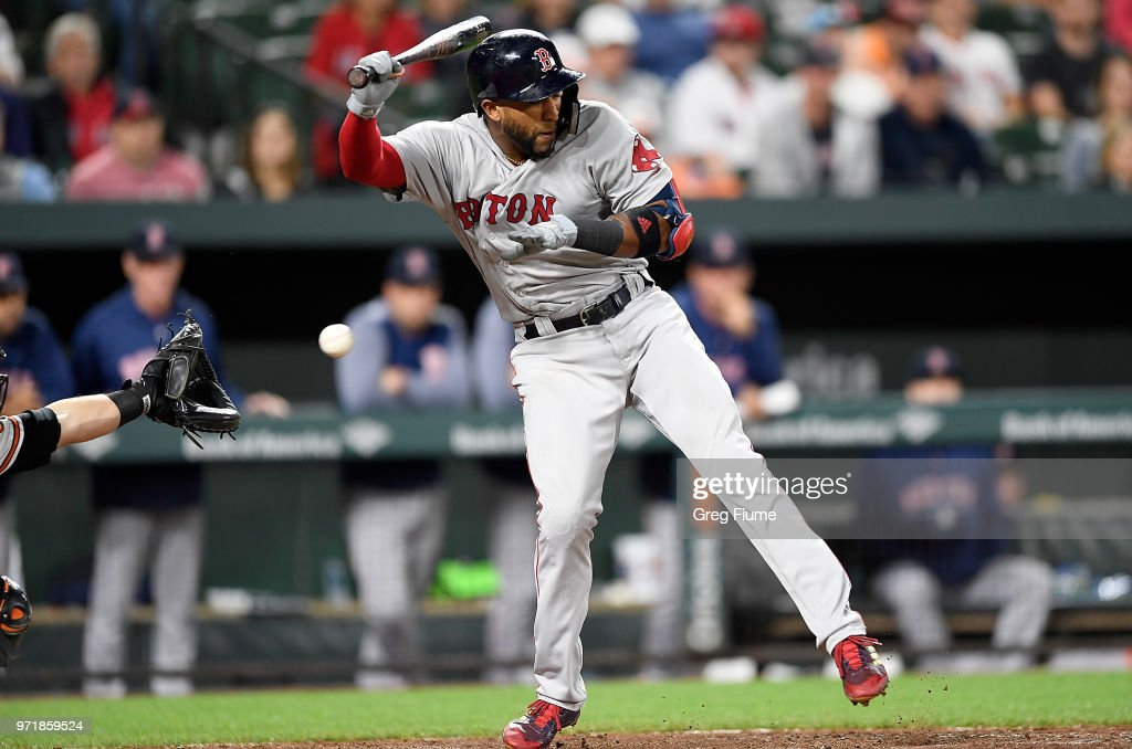 Eduardo Nunez #36 of the Boston Red Sox is hit by a pitch in the 12th inning against the Baltimore Orioles at Oriole Park at Camden Yards on June 11, 2018 in Baltimore, Maryland.
