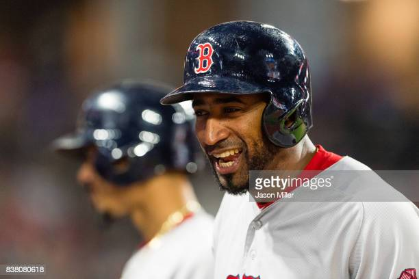 Eduardo Nunez of the Boston Red Sox jokes with his teammates during a pitching change during the eighth inning against the Cleveland Indians at...