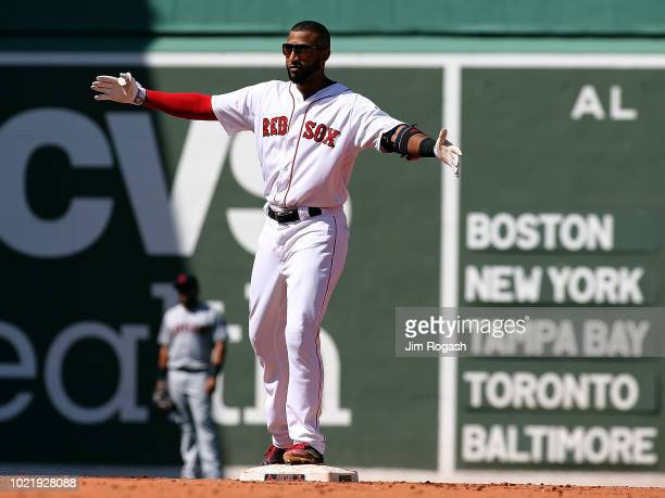 Eduardo Nunez of the Boston Red Sox reacts after knocking in two runs in the fifth inning against the Cleveland Indians in the third inning at Fenway...