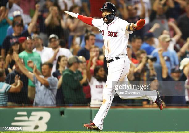 Eduardo Nunez of the Boston Red Sox reacts as he crosses home plate after scoring on a gamewinning walkoff groundrule double hit by Blake Swihart of...
