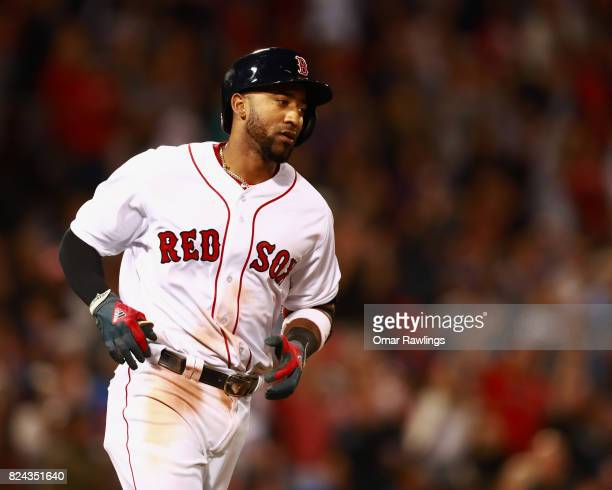 Eduardo Nunez of the Boston Red Sox rounds the bases after hitting a home run in the bottom of the fifth inning during the game against the Kansas...