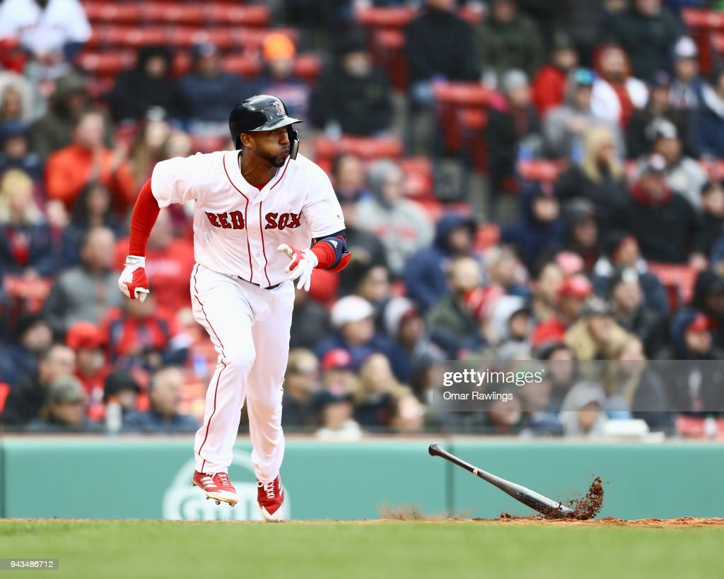 Eduardo Nunez #36 of the Boston Red Sox singles of a line drive to centerfield in the bottom of the eighth inning of the game against the Tampa Bay Rays at Fenway Park on April 8, 2018 in Boston, Massachusetts.