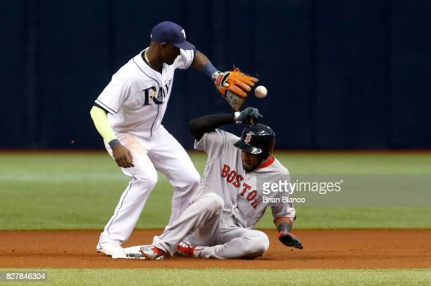 Eduardo Nunez of the Boston Red Sox slides safely into second base ahead of shortstop Adeiny Hechavarria of the Tampa Bay Rays after hitting a double...
