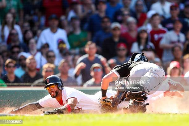 Eduardo Nunez of the Boston Red Sox slides safely past the tag of James McCann of the Chicago White Sox to score in the eighth inning of a game at...