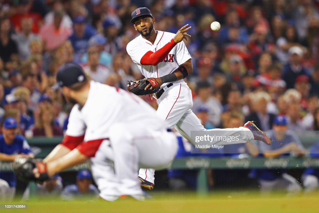 Eduardo Nunez #36 of the Boston Red Sox throws to first to force out Lourdes Gurriel Jr. #13 of the Toronto Blue Jays during the seventh inning at Fenway Park on September 11, 2018 in Boston, Massachusetts.