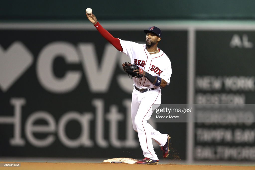 Eduardo Nunez #36 of the Boston Red Sox turns a double play against the Oakland Athletics during the eighth inning at Fenway Park on May 16, 2018 in Boston, Massachusetts.