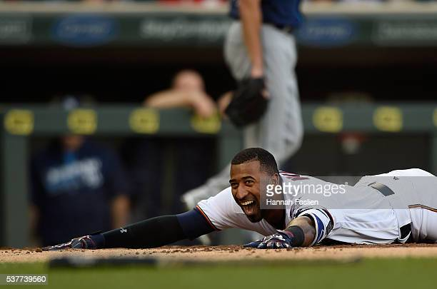 Eduardo Nunez of the Minnesota Twins lays on home plate after hitting an inside the park home run against the Tampa Bay Rays during the first inning...