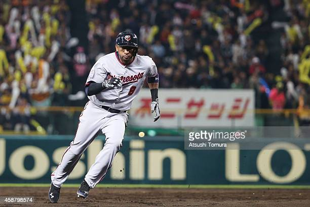 Eduardo Nunez of the Minnesota Twins runs the bases during the friendly match between Hanshin Tigers and Yomiuri Giants at the Hanshin Koshien...